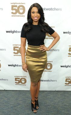 At the Weight Watchers 50th anniversary in New York, Jennifer Hudson dons a Donna Karan metallic pencil skirt that highlights her slim figure.