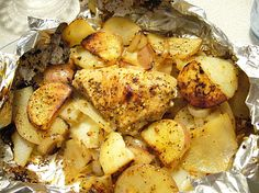 Grilled Packets - Hobo Dinner - Chicken, potatoes, onions, spices, salt & pepper. Carrots could be added.