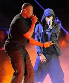 Eminem and Dr. Dre rapping in concert