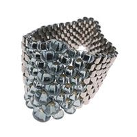 Flat, even count peyote stitch ring: Create this effect by increasing seed bead size, then decreasing. Simple design, yet makes a statement.