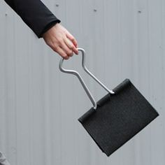The Clip Bag by Peter Bristol is a giant version of the classic binder clip made with wool felt and aluminum tubing.