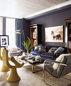 youthful, fun hand furniture, great photography, very traditional bookcases, modern lighting, mixing of gold and silver metal accents, deep colors with lots of light,