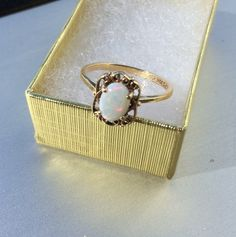 Check out this item in my Etsy shop https://www.etsy.com/listing/202877122/vintage-10k-yellow-gold-opal-filigree