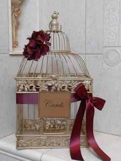 birdcage wedding decor with marsala ribbon