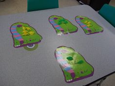 Students count out miniature dinosaurs according to the numeral on each Dinosaur mat. (Number recognition and correspondence)
