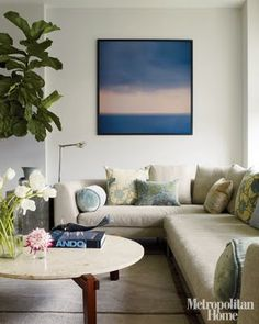 DIY inspiration.this one would be so very easy to do.  Notice how the Beige ties to the color of the couch.  It makes it work in the room. Defiantly doing this one.