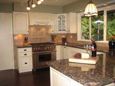 Mannequin Cream (Benjamin moore OC-92) is the PERFECT kitchen cabinet color....maybe?