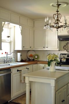 The cabinets are  Benjamin Moore Linen white which is a warm white - use for white trim and to paint vanity and light fixture in Upstairs Bathroom