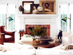 Brick fireplace styled with framed artwork and old clock