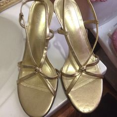 Ralph Lauren sandal It's a metallic gold strappy open toed sandall. Brand new, no tags. Heel is not too high !! Excellent and elegant !!! Ralph Lauren Shoes