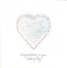An embroidered white heart created on white satin with iridescent fibres stitched with white satin threads. #WeddingDay #WeddingCards #HandmadeCard