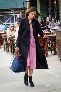 Alexa Chung   pink midi flowy dress + black midi coat + black leather cowboy boots