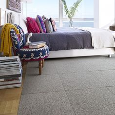 A soft loop construction that mixes and matches easily with most FLOR styles. Laid in a solid color, its beveled edges introduce another design element - the classic grid. Looks best laid straight. 100% recycled Nylon face fibers. Made in the USA. Style not eligible for cutting service.