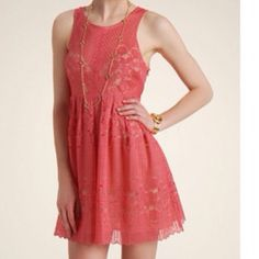 NWT Free People 'Rocco' cutout lace dress. Size 4 A free People lace dress with lining. Pleats add volume to the skirt, cutout back closes with a single button. Side zipper. Coral color . Size 4. New with tags Free People Dresses Mini