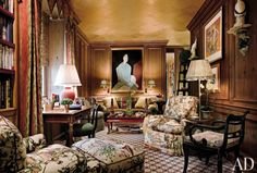 TRADITIONAL OFFICE/LIBRARY BY MARIO BUATTA To create the library of a Manhattan penthouse, designer Mario Buatta merged two small bedrooms, then paneled the resulting room in pine. The portrait is by Chiu Ya-tsai; a work by Vulliamy is at right.