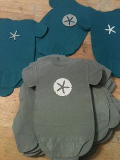 Pack of 30 baby shower onesie napkins.  Beach, under the sea theme with starfish and sand dollars.. $30.00, via Etsy.