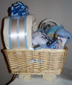 New #Puppy Carriage Gift Basket for #Dogs (Blue) by Purrfectly Rebarkable #Pets Congratulations! It's a new puppy! This new puppy shower gift basket for dogs comes in the form of a baby carriage, loaded with puppy gifts and treats for a new best friend! We have decorated our favorite collection of gifts for a new puppy in a wicker basket with puppy training pad wheels and a training pad canopy to give the appearance of a welcome baby carriage.