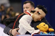 Yuzuru Hanyu and coach Brian Orser after his long program at Cup of China 2014. Hanyu had collided with Han Yan during the 6 minute warm up and they suffered head injuries, despite this both skaters still finished competing.