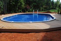 above ground built into ground with wooden deck. http://www.abovegroundpoolbuilder.com/pool-deck-ideas-for-everyone