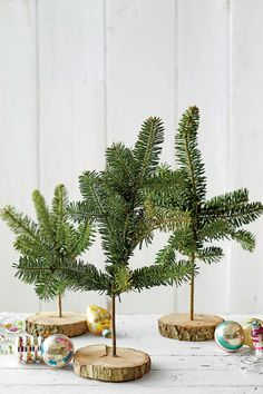 "Create a Tabletop Display - Four Crafts for Your Extra Christmas Tree Branches - Southernliving. Start with long, skinny branches. Drill a hole in the center of a small wooden disk. Place a dab of hot glue into the hole, and drop in the ""tree."" If needed, wire on additional ""branches"" to fill it out."