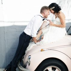 These two are so cute! Love the old VW bug and their fun wedding attire! Photo by Jana Williams