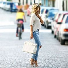 This Instagrammer is wearing a loose knit top and distressed jeans with studded blush pink stilettos. Jeans/Top: Zara, Shoes: Valentino