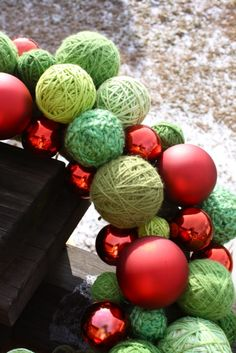 diy christmas wreath with old ornaments and yarn balls....next year