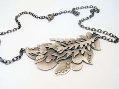 Kayleigh Biggs, sterling silver necklace with gold accents.