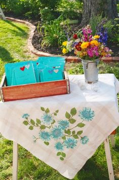 Great for guest book table...in Mags colors...see if either grandma has vintage table cloth