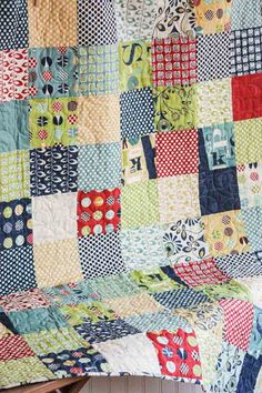 Too cute for words! This sweet baby quilt was pieced together with the gorgious fabric collection called Social Club designed by The Comstocks