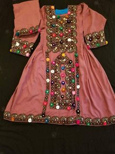 This teapink balochi suit for kids Fully hand embroidered very beautiful and elegant Piece. Perfect for Eid season Size# 7 to 8 years Length 34 Shalwar length Care Pakistani Kids Dresses, Pakistani Dress Design, Pakistani Outfits, Pakistani Clothing, Indian Clothes, Indian Dresses, Simple Dresses, Cheap Dresses, Balochi Dress
