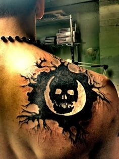 Dark Black Ink Gears Of War Tattoo Behind Right Shoulder
