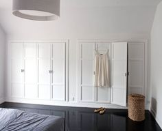 A wall of closets with doors that aren't hideous!