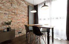 Cegła na ścianie: ciekawy projekt mieszkania w Krakowie