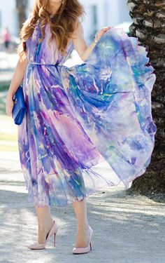 With its passionate watercolor print and fluid gossamer gown sway, this watercolor floral maxi slip dress offers up a refreshing first-of-summer look! Floral Watercolor Maxi Slip Dress in Violet featured by Jimmychoosandtennisshoes Blog