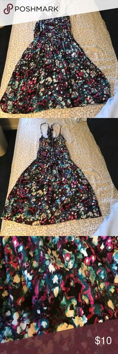 Floral Patterned Racerback Sundress Fun and flirty racerback sundress! Never worn, tags removed. Fits more like a medium. Wet Seal Dresses