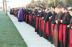 Seminarians praying outside an abortion clinic. Pray for our priests.