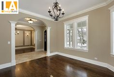 Tiled Entry -- love the white trim with the brown wood floors and colored walls :)