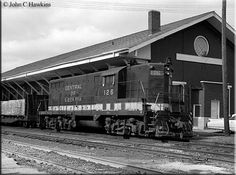 Central of Georgia GP7 № 126 sits at the freight depot in Huntsville, AL with a short cut of cars, in March 1971.