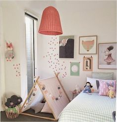 not sure where to begin with this perfectly decorated kid's room: the beautiful pendant light, the perfectly scattered dots, the gorgeous little tent, the lovely art...  Love it all.  #estella #kids #decor