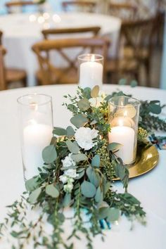 Simple Do-It-Yourself Cheap Wedding Centerpieces Ideas Rustic greenery seeded eucalyptus and candle wedding centerpiece ideas Romantic Wedding Centerpieces, Wedding Table Centerpieces, Wedding Flower Arrangements, Flower Centerpieces, Wedding Bouquets, Wedding Decorations, Wedding Round Table Flowers, Wedding Ideas Candles, Rustic Candle Centerpieces
