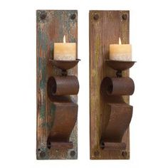 "Lend a touch of rustic-chic appeal to your entryway or living room with this charming wood wall sconce, showcasing a scrolling iron candleholder and warmly weathered finish.  Product: 2 Wall sconcesConstruction Material: Iron, fir wood and polystoneFeatures: Scrolling detailsAccommodates: (1) Candle each - not includedDimensions: 19"" H x 6"" W x 4"" D each"
