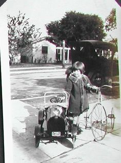 shiny new pedal car and a trike