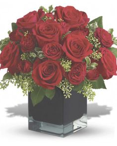 Lush, lavish and spectacularly chic, this gorgeous contemporary bouquet of red roses in a stunning black cube vase makes an exciting gift for almost anyone. Wouldn't you love for someone to send it to you? Christmas Flower Arrangements, Artificial Flower Arrangements, Christmas Flowers, Beautiful Flower Arrangements, Floral Arrangements, Seasonal Flowers, Silk Flowers, Beautiful Flowers, Pretty Roses