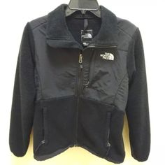 North Face Denali fleece black women's small The Northface women's Denali jacket  Women's size small  Polartec recycled material  Shell A 100% Polyester  Shell B 100% Nylon  Measures approximately: shoulders 15 inches, bust 40 inches, waist 40 inches, length 24.5 inches.  Minor signs of use such as pilling, but in overall good to very good pre-owned condition with no major imperfections.  #102-6 North Face Jackets & Coats