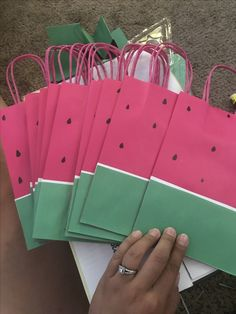 Watermelon goodie bag, watermelon party, DIY party bag, favors, pink bags, green and white construction paper and watermelon seeds made by using a black marker