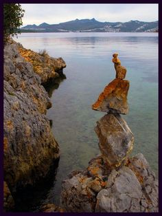 Bitez, Do you see the woman on the top of this cairn clutching something to her heart?