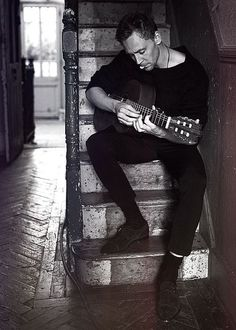 Tom Hiddleston with a guitar. You're welcome