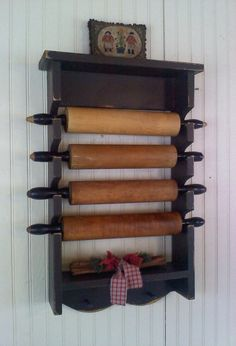 Rolling Pin Display. I really need something like this to display mine. I love rolling pins and the older the better.