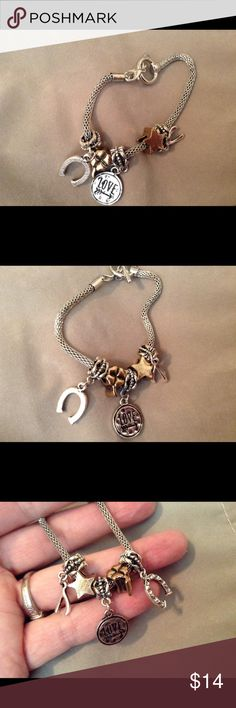 "Charm Bracelet With 5 Charms & Toggle Closure This Is A Really Nice Charm Bracelet That's Silver Toned And Includes 5 Charms All In Excellent Undamaged Condition! Have Had For over 1 Year And Has Never Turned! It's Too Small For my Wrist It Will Fit A 7"" Or Smaller Wrist The Total Length Is 7"" including the Closure Ring And Toggle thanks! Great Gift for Christmas!❤️24 HOUR SALE❤️ Jewelry Bracelets"
